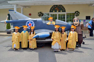 Children pose on graduation day at Anna House, the day care and preschool at Belmont Park Race Track. A sister center will open at Saratoga Race Course, hopefully next summer.