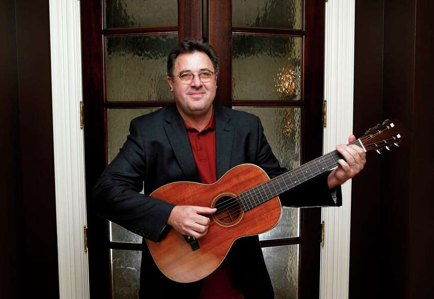 FILE - In this Feb. 1, 2016 file photo, Vince Gill poses for a photo at his home in Nashville, Tenn. Gill doesna€™t hold back on weighty topics of regret, faith, his marriage and sexual abuse on his new record a€œOkiea€ coming out on Aug. 23, 2019. The Grammy-winner admitted to breaking down in the studio as he sang a song for his wife, Amy Grant, but he said therea€™s a lot of emotion tied up his songs, some of which he waited a lifetime to write and record. (Photo by Donn Jones/Invision/AP, file)