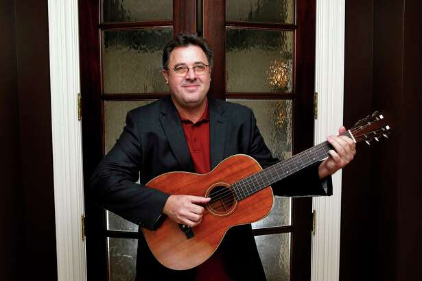 FILE - In this Feb. 1, 2016 file photo, Vince Gill poses for a photo at his home in Nashville, Tenn. Gill doesna€™t hold back on weighty topics of regret, faith, his marriage and sexual abuse on his new record a€œOkiea€ coming out on Aug. 23, 2019. The Grammy-winner admitted to breaking down in the studio as he sang a song for his wife, Amy Grant, but he said therea€™s a lot of emotion tied up his songs, some of which he waited a lifetime to write and record. (Photo by Donn Jones/Invision/AP, file)