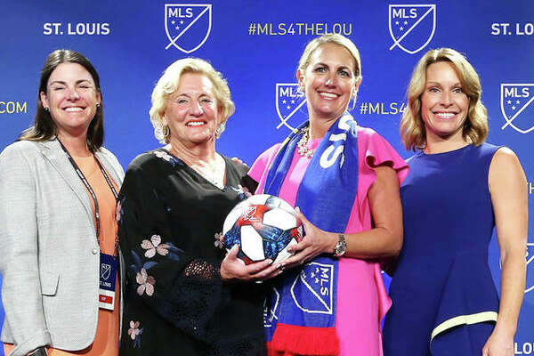 Four members of the new St. Louis Major League Soccer franchise ownership group, pose for photos following the announcement Tuesday in St. Louis. From left are) are Patty Taylor, Jo Ann Taylor Kindle, Carolyn Kindle Betz, and Chrissy Taylor. This group is the only all female owned franchise in MLS.