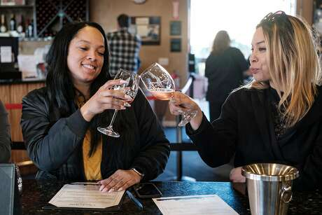 Vernita James (left) and Nicole Fauss taste wines in the indoor tasting room at Rock Wall. Photo: Michael Short / Special To The Chronicle
