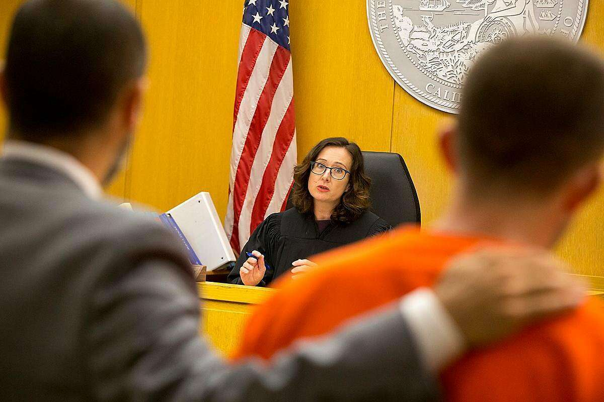 Judge Christine Van Aken addresses Austin James Vincent, a suspect in a highly-publicized attack outside a condo building near the Embarcadero, and his attorney, Saleem Belbahri, during a preliminary hearing at the Hall of Justice on Tuesday, Aug. 20, 2019. (Kevin N. Hume/S.F. Examiner)