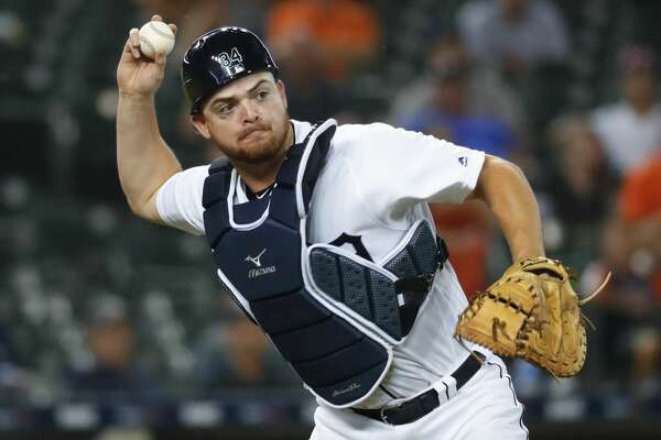 Detroit Tigers catcher Jake Rogers throws to first base for an out on a Chicago White Sox's Leury Garcia sacrifice bunt in the eighth inning of a baseball game in Detroit, Monday, Aug. 5, 2019. (AP Photo/Paul Sancya)