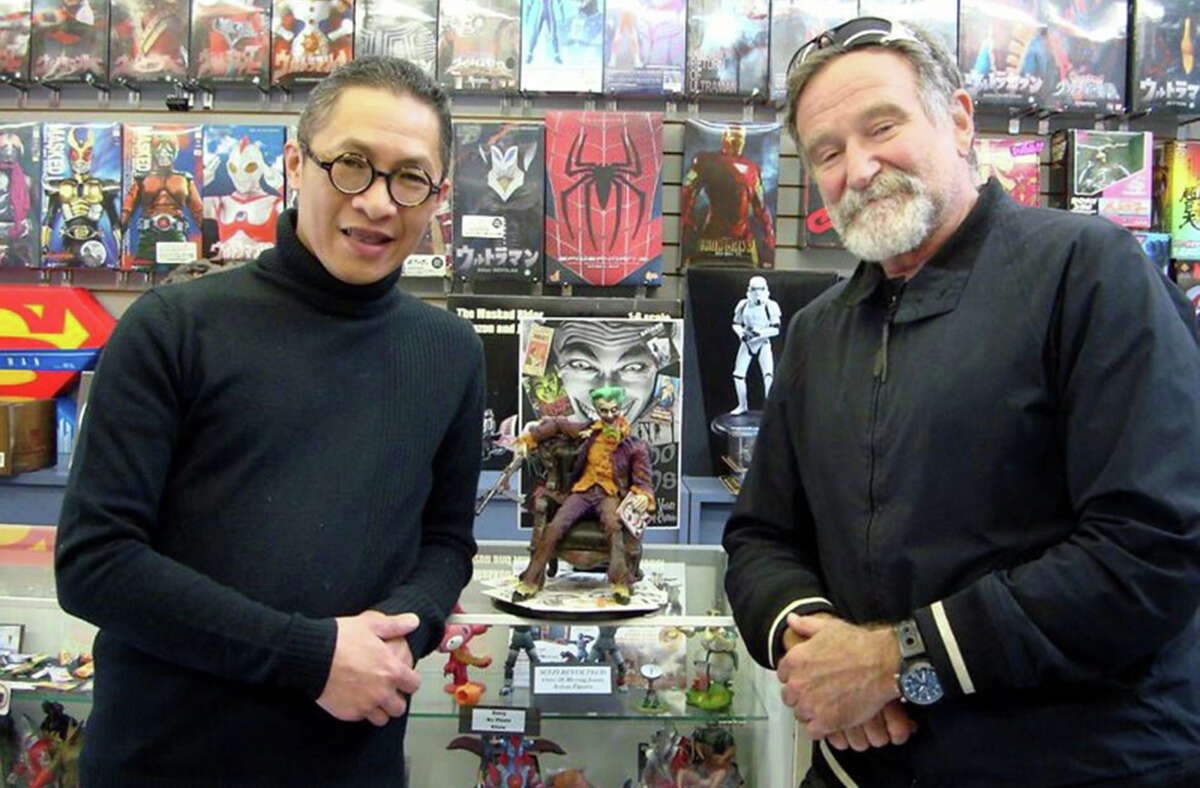 """Robin Kwok and Robin Williams pose with a custom model from """"The Man Who Laughs."""""""