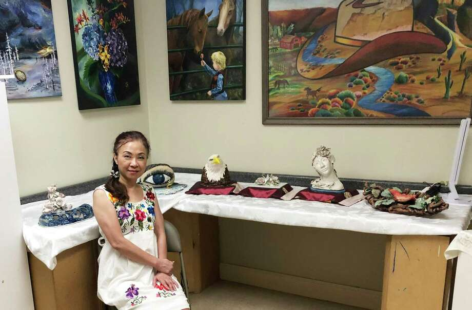 "Sulin Huang, ""Ms. Sue,"" has a studio in Sugar Land, where she teaches children how to create art. Many of her students' pieces are successful at competitions. Photo: Courtesy Photo"