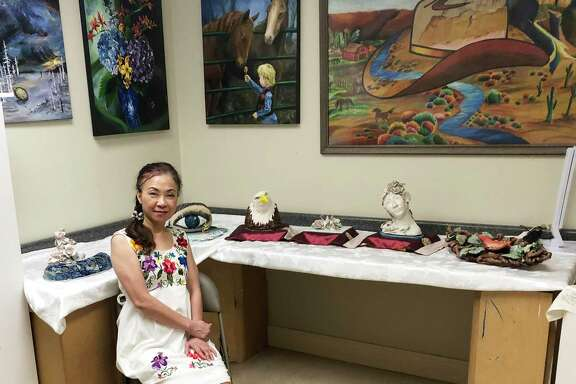 """Sulin Huang, """"Ms. Sue,"""" has a studio in Sugar Land, where she teaches children how to create art. Many of her students' pieces are successful at competitions."""