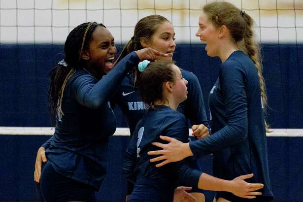 Kingwood outside hitter Breanna Burrell (31) reacts with teammates after scoring a poiint in the first set of a match during the Kingwood Invitational volleyball tournament at Kingwood High School, Thursday, Aug. 15, 2019, in Kingwood.