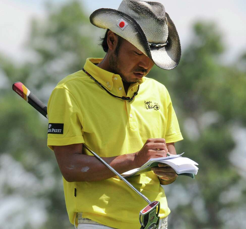 Japanese golfer Shingo Katayama writes on his scorecard during the third round of the US Masters at the Augusta National Golf Club on April 11, 2009. AFP PHOTO/Don EMMERT (Photo credit should read DON EMMERT/AFP/Getty Images)