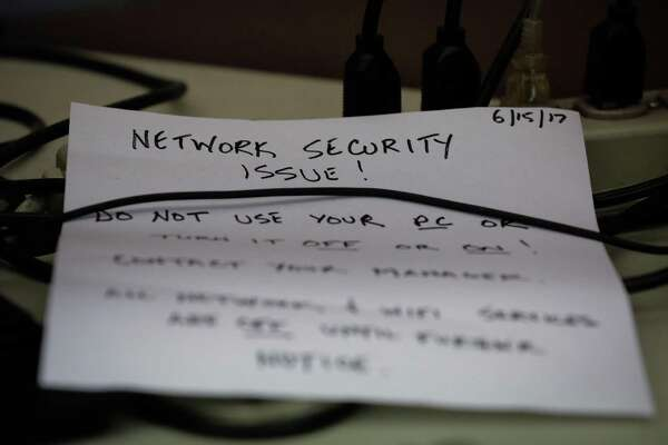 A note is seen near a computer addressing the ransomware attack that infected KQED's internal operations at KQED in San Francisco, Calif., on Monday, July 17, 2017.