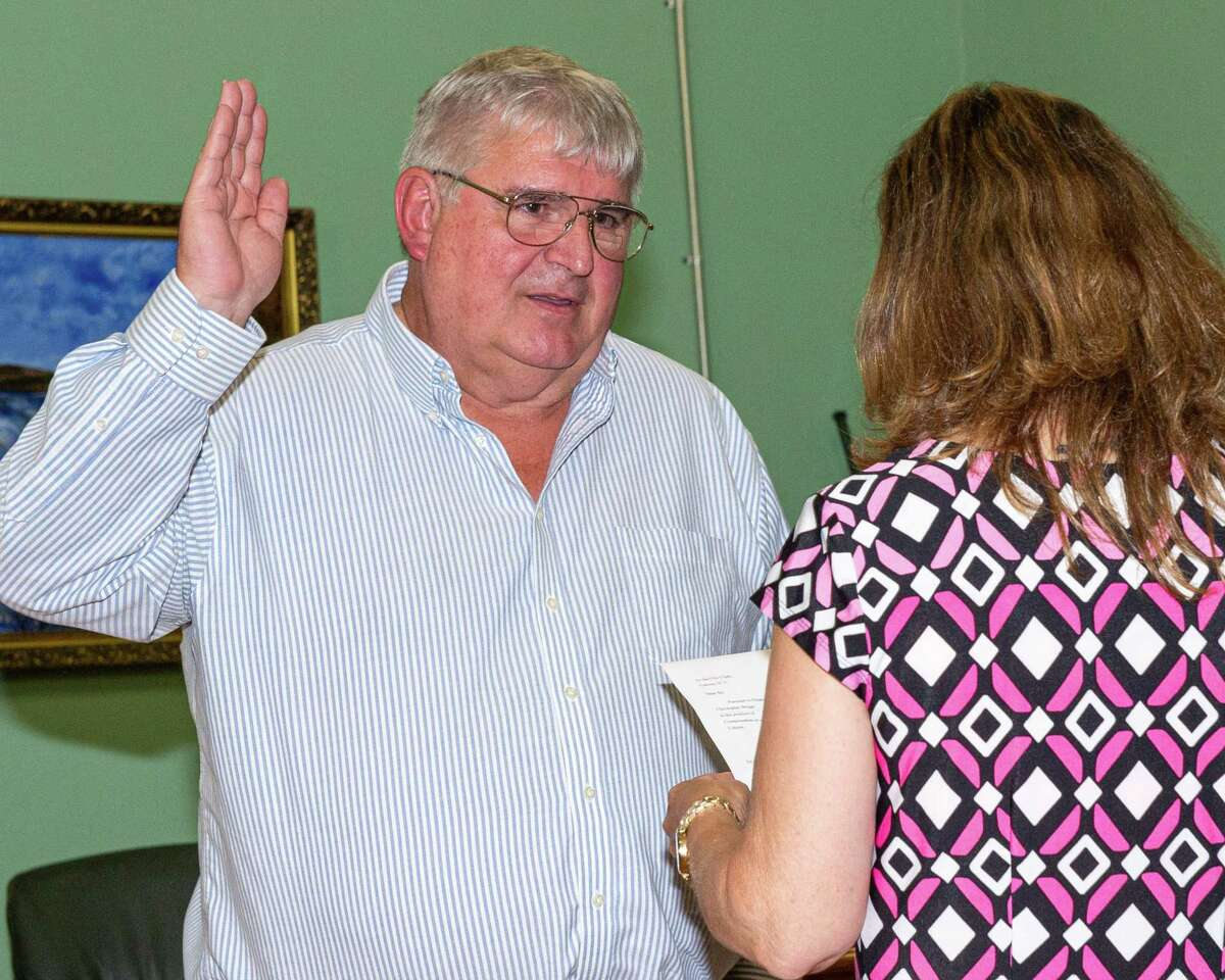 Mayor Chris Briggs, the former Common Council president, is sworn in after a vote to remove Mayor Shawn Morse from office on Tuesday, Aug. 20, 2019 at Cohoes City Hall (Jim Franco/Special to the Times Union.)