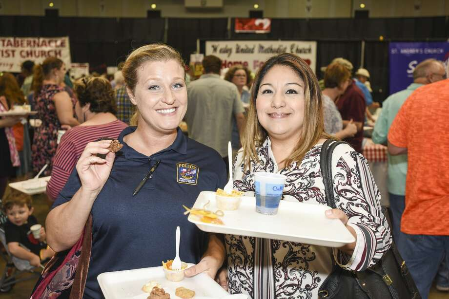 People at the Some Other Places' food tasting in the Beaumont Civic Center on Tuesday. Photo taken on Tuesday, 08/20/19. Ryan Welch/The Enterprise Photo: Ryan Welch/The Enterprise