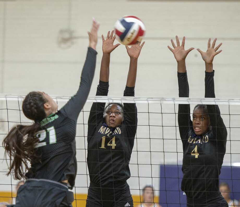Midland High's Joslyn Prince (14) and Aniya Clinton (4) attempt to block Monahan High's Janely Leyva's (21) hit on Tuesday, Aug. 20, 2019 at Midland High School.  Jacy Lewis/Reporter-Telegram Photo: Jacy Lewis/Reporter-Telegram