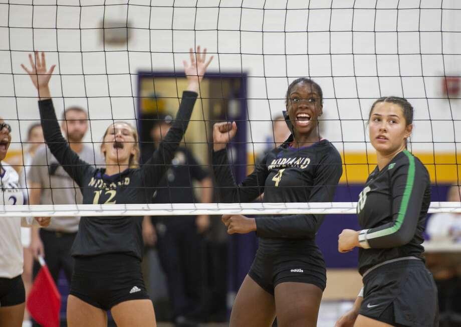 Midland High's Aniya Clinton (4) celebrates a spike on Tuesday, Aug. 20, 2019 at Midland High School.  Jacy Lewis/Reporter-Telegram Photo: Jacy Lewis/Reporter-Telegram