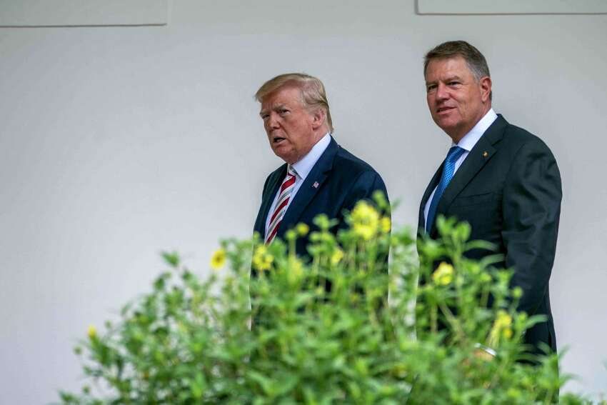 President Donald Trump walks with President Klaus Iohannis of Romania at the White House, in Washington on Tuesday, Aug. 20, 2019. (Doug Mills/The New York Times)