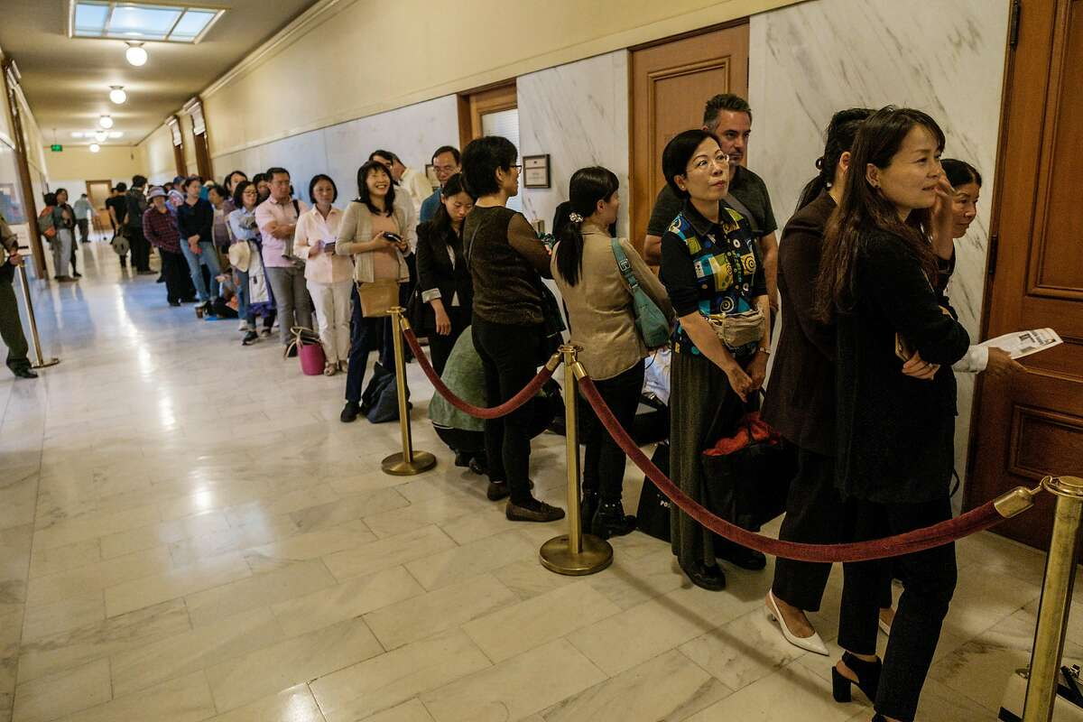 August 20, 2019 - People are seen outside of the chambers in City Hall before the SFMTA board meets to take a second vote on naming the Chinatown Central Station after divisive local political figure Rose Pak.