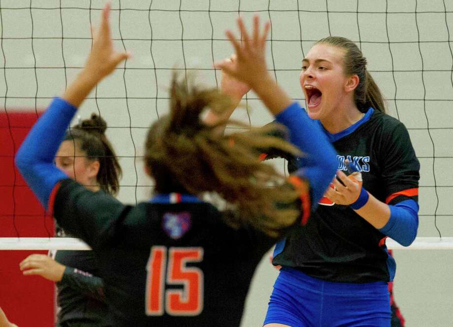 Grand Oaks middle blocker Kamie Lohnes (5) reacts after a point during the first set of a non-district high school volleyball match at Oak Ridge High School, Tuesday, Aug. 20, 2019, in Oak Ridge. Photo: Jason Fochtman, Houston Chronicle / Staff Photographer / Houston Chronicle