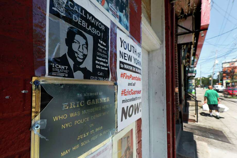 A make-shift memorial to Eric Garner is affixed to a building wall, Tuesday, Aug. 20, 2019, where he died in a police chokehold five years ago, in the Staten Island borough of New York.  Police Commissioner James O'Neill announced Monday that he has fired Officer Daniel Pantaleo based on a recent recommendation of a department disciplinary judge. (AP Photo/Richard Drew) Photo: Richard Drew / Copyright 2019 The Associated Press. All rights reserved