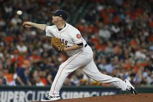 Houston Astros relief pitcher Brad Peacock (41) pitches after replacing starting pitcher Aaron Sanchez during the third inning of an MLB game at Minute Maid Park, Tuesday, August 20, 2019.