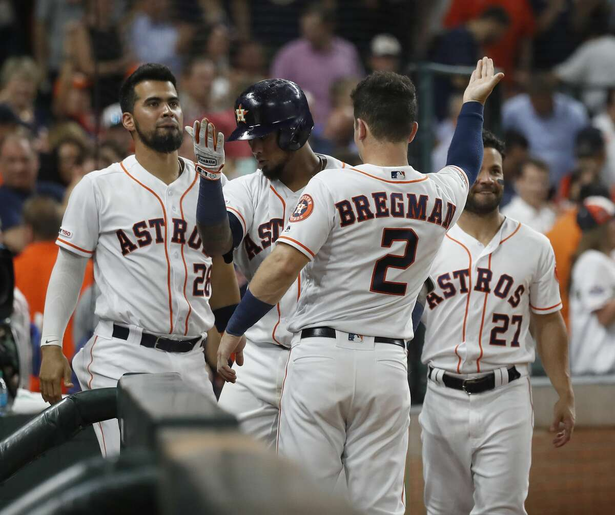 Houston Astros Martin Maldonado (12) celebrates with Alex Bregman (2) after his home run during the fifth inning of an MLB game at Minute Maid Park, Tuesday, August 20, 2019.