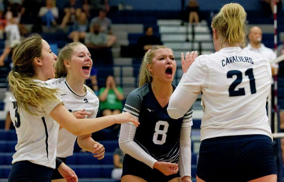 College Park players are shown during a match last week at Kingwood. On Tuesday night, the Lady Cavaliers defeated defending Class 5A state champs Kingwood Park in four sets. Photo: Jason Fochtman, Houston Chronicle / Staff Photographer / Houston Chronicle