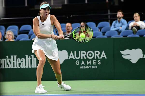 Team World's Belinda Bencic hits the ball during a singles tennis match against Team America's Monica Puig during opening night of the Aurora Games at the Times Union Center on Tuesday, Aug. 20, 2019 in Albany, N.Y. (Lori Van Buren/Times Union)