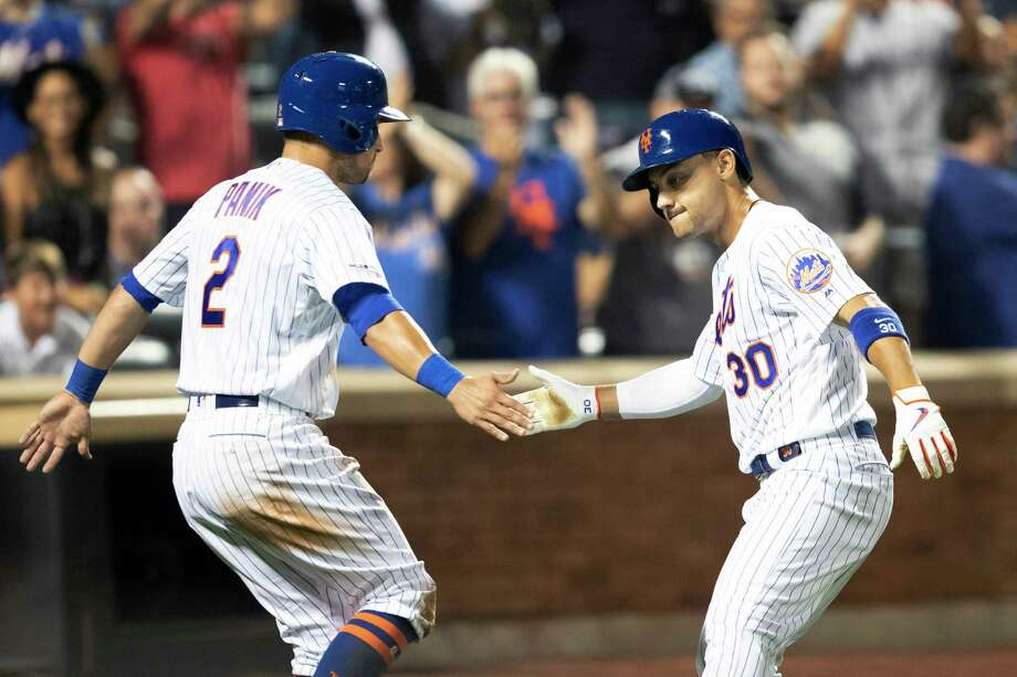 New York Mets' Michael Conforto (30) celebrates hitting a home run with Joe Panik (2) during the sixth inning of a baseball game against the Cleveland Indians, Tuesday, Aug. 20, 2019, in New York. (AP Photo/Mary Altaffer) Photo: Mary Altaffer / Copyright 2019 The Associated Press. All rights reserved.
