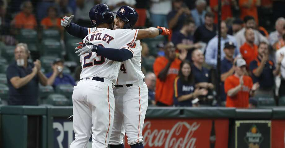 Houston Astros George Springer (4) celebrates his home run with Michael Brantley (23) during the first inning of an MLB game at Minute Maid Park, Tuesday, August 20, 2019. Photo: Karen Warren/Staff Photographer