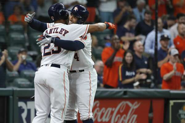Houston Astros George Springer (4) celebrates his home run with Michael Brantley (23) during the first inning of an MLB game at Minute Maid Park, Tuesday, August 20, 2019.