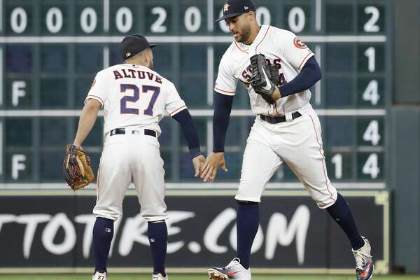 Houston Astros center fielder George Springer (4) and second baseman Jose Altuve (27) celebrate the Astros 6-3 win over the Detroit Tigers after the final out in the ninth inning of an MLB game at Minute Maid Park, Tuesday, August 20, 2019.