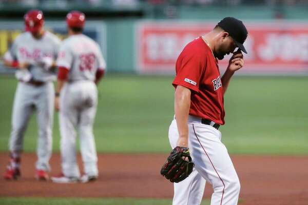 Boston Red Sox starting pitcher Brian Johnson heads to the dugout after working the first inning of the team's baseball game against the Philadelphia Phillies at Fenway Park in Boston, Tuesday, Aug. 20, 2019. Johnson allowed three earned runs in the first to start his outing. (AP Photo/Charles Krupa)