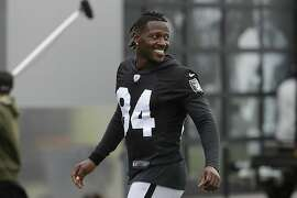 Oakland Raiders' Antonio Brown smiles before stretching during NFL football practice in Alameda, Calif., Tuesday, Aug. 20, 2019. (AP Photo/Jeff Chiu)