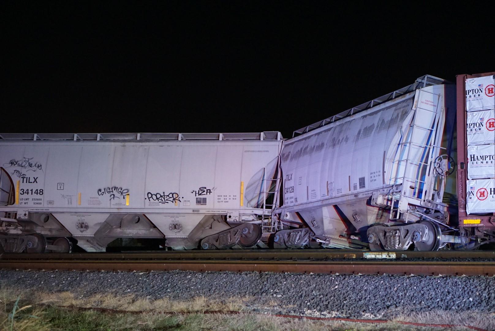 Four cars from train derail near downtown