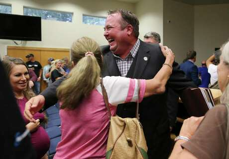 """Cibolo Mayor Stan """"Stosh"""" Boyle reacts after a council vote resulted in his keeping his elected position. Boyle was the subject of a hearing because he was convicted of a felony in 1998 and state law prohibits anyone for running for or holding elected office if he or she has a felony conviction. But Boyle argued that he successfully completed his probated sentence and thus is once again eligible to serve. That's contrary to state attorney general opinions, but it was noted in the court that those opinions aren't the same as a court decision. The council voted 3-3 on a motion to remove him; the city charter requires six votes to remove a council member. (Kin Man Hui/San Antonio Express-News)"""