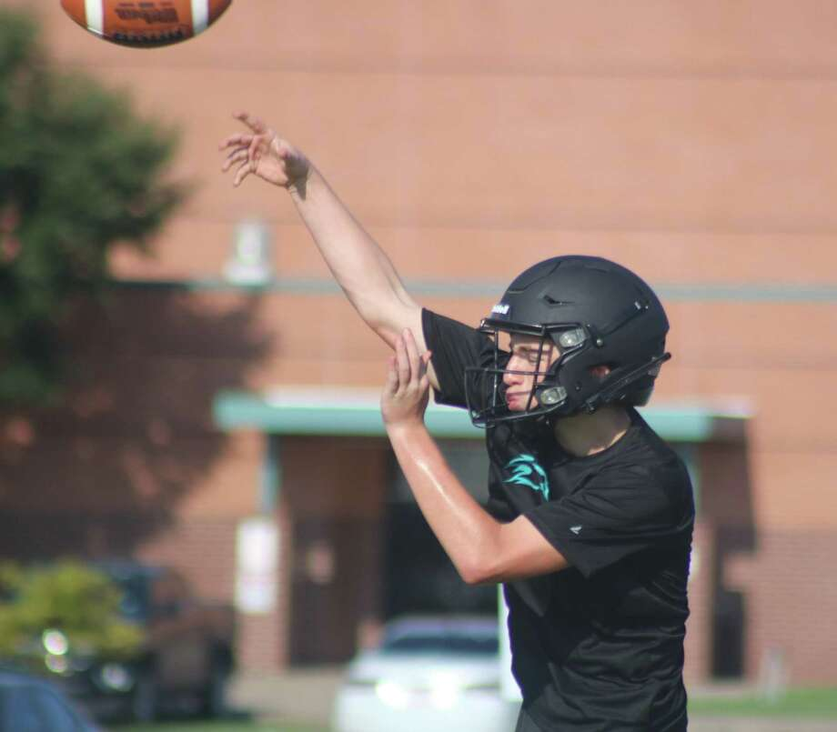 A Memorial High School quarterback works on his passing accuracy during a workout earlier this month. The Mavs offense has one last scrimmage with another opponent before they formally open their 16th season. Photo: Robert Avery