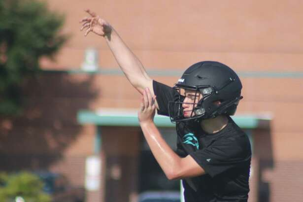 A Memorial High School quarterback works on his passing accuracy during a workout earlier this month. The Mavs offense has one last scrimmage with another opponent before they formally open their 16th season.