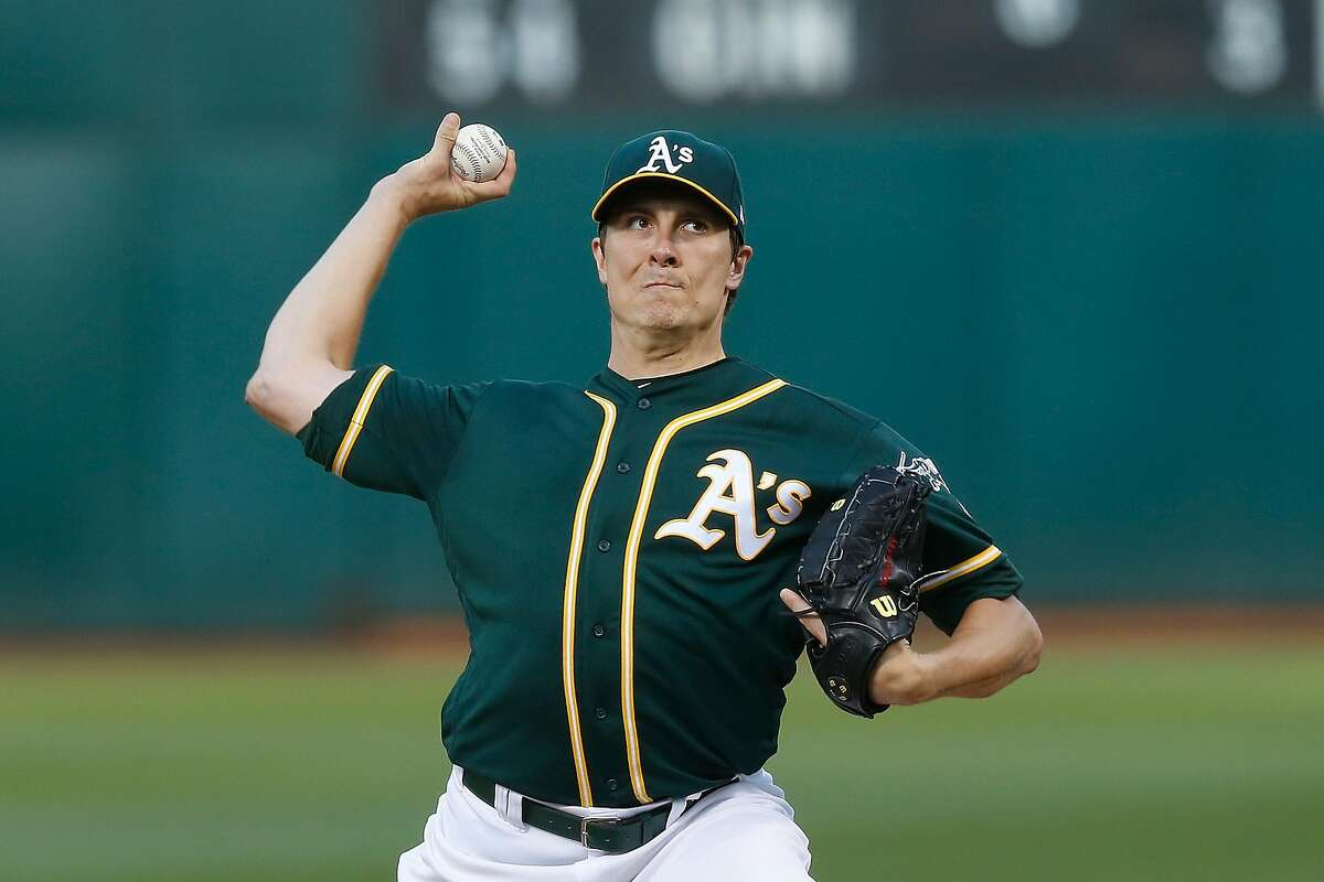OAKLAND, CALIFORNIA - AUGUST 20: Homer Bailey #15 of the Oakland Athletics pitches in the top of the first inning against the New York Yankees at Ring Central Coliseum on August 20, 2019 in Oakland, California. (Photo by Lachlan Cunningham/Getty Images)