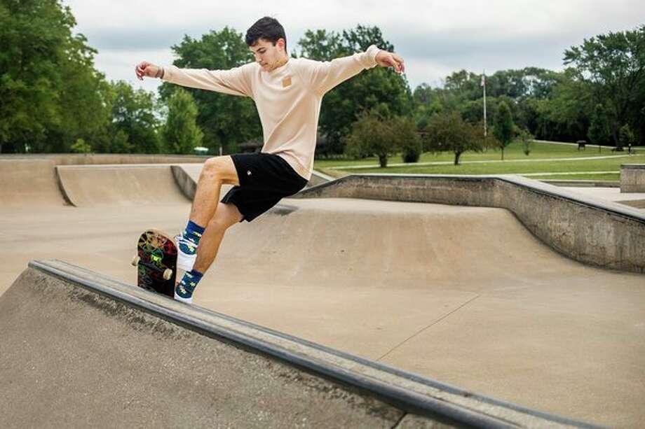 Jackson Zienert of Midland, 16, rides his skateboard at Trilogy Skatepark Tuesday afternoon. (Katy Kildee/kkildee@mdn.net)