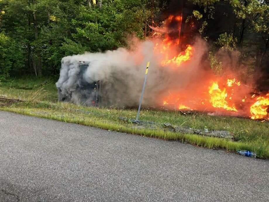 State Police said a pick-up truck caught fire Tuesday on the Northway in Elizabethtown after a tire a trailer it was hauling blew and the truck plowed into the median. Photo: New York State Police