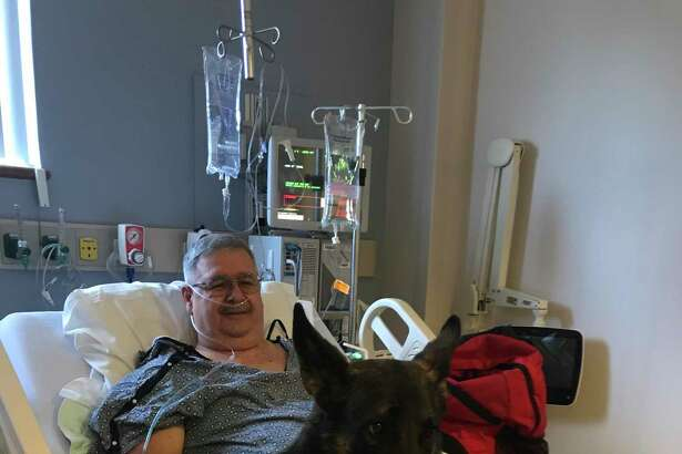 Charlie Amico and his medical service dog, Harry.