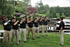 A 21-gun salute is given during a ceremony recognizing the renaming of the Brookfield VFW in local Navy SEAL Jason Lewis' honor. The ceremony was held at the organization's headquarters on Candlewood Lake Road on Saturday, Aug. 17.