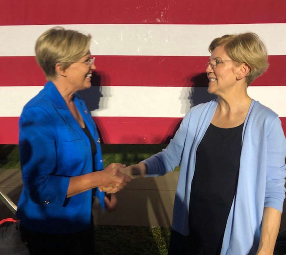 Stephanie Oyen and Sen. Elizabeth Warren, D-Mass., shake hands Monday after a rally at Macalester College in Minnesota. Photo: Photo Courtesy Of Stephanie Oyen / Courtesy