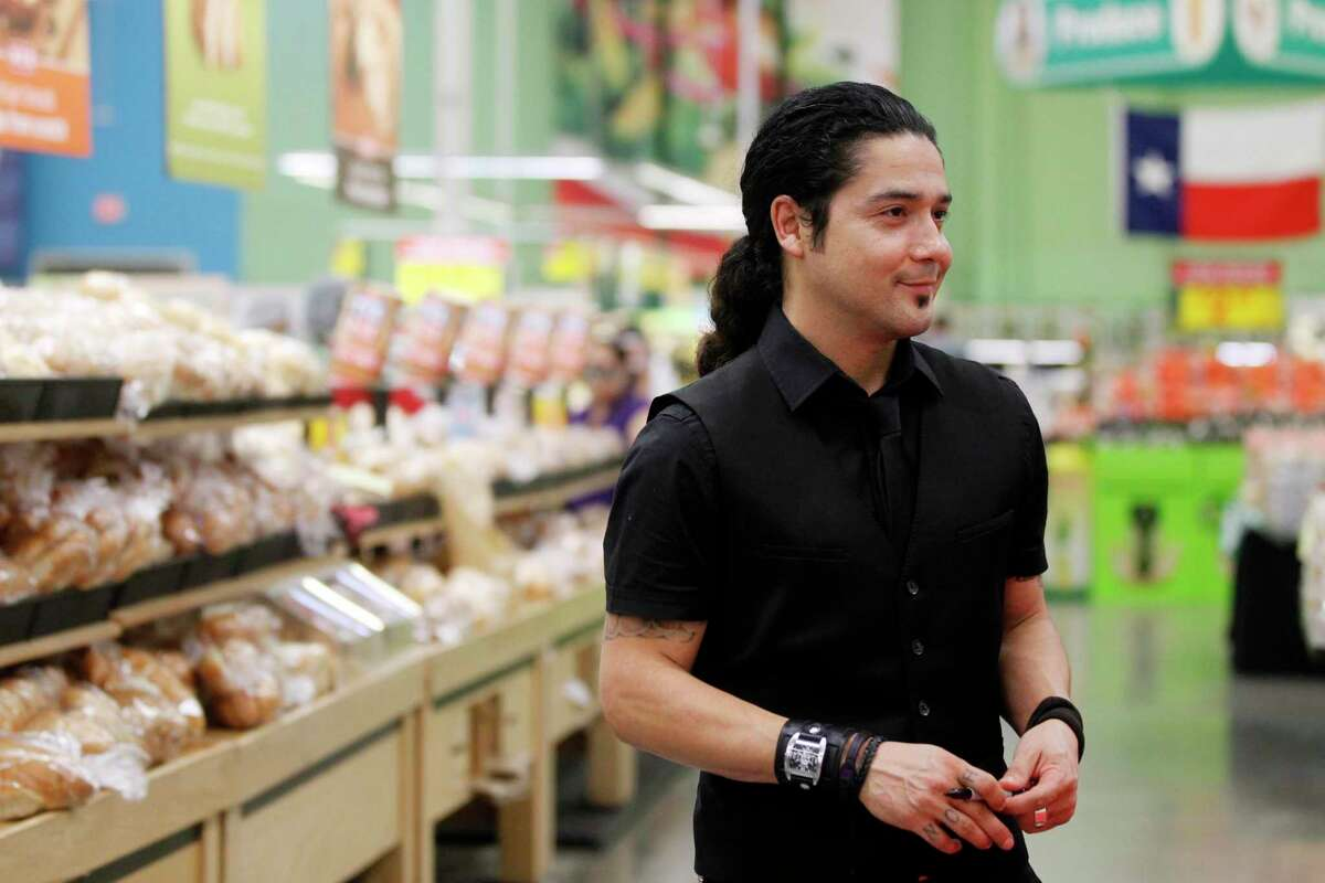Chris Perez poses for pictures Wednesday, March 7, 2012 during a book signing at the H-E-B Plus in Corpus Christi, Texas. Perez wrote the new book,