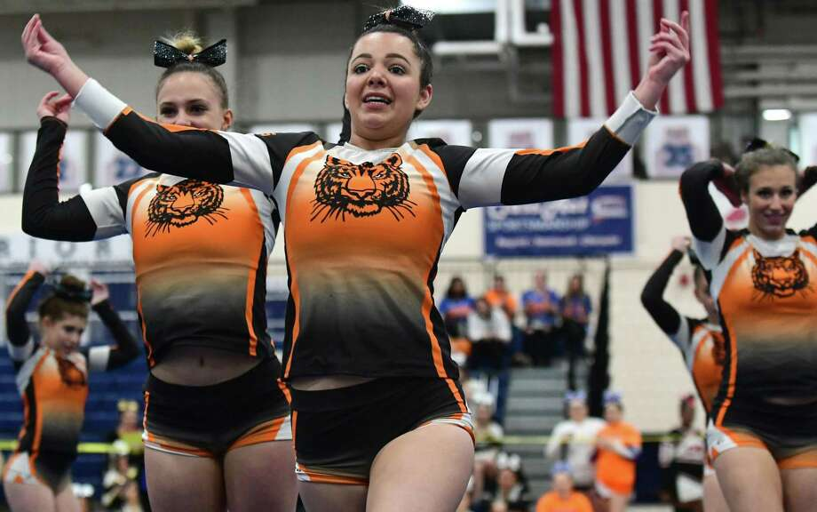 Alexandra Westrick and The Ridgefield High School Varsity Cheerleading Squad competes in the 22nd annual FCIAC cheerleading championships Saturday, February 2, 2019, at Wilton High School in Wilton, Conn. Photo: Erik Trautmann / Hearst Connecticut Media / Norwalk Hour