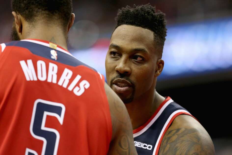WASHINGTON, DC - NOVEMBER 02: Dwight Howard #21 of the Washington Wizards speaks to Markieff Morris #5 of the Washington Wizards during the first half against the Oklahoma City Thunder at Capital One Arena on November 2, 2018 in Washington, DC. (Photo by Will Newton/Getty Images)