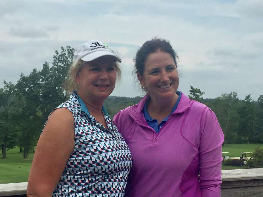 Kate Becker (right) won the 18-hole division at the Ridgefield Ladies Golf Association's President's Cup tournament. With Becker is Donna Baron, the nine-hole division champion. Photo: Contributed Photo