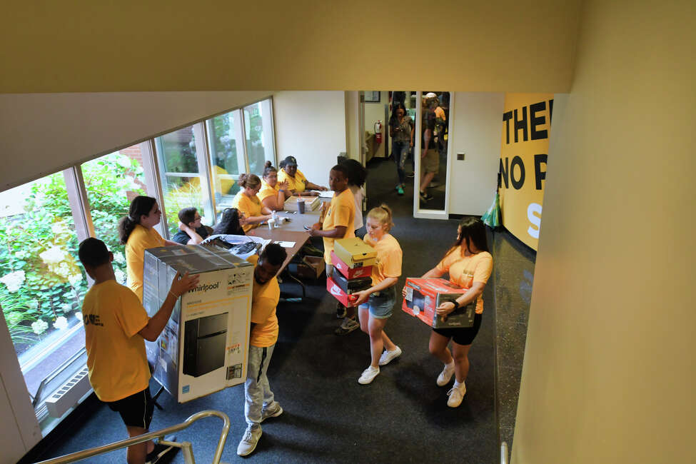 Upper class students help to carry in the dorms the belongings of new students during move-in day at The College of Saint Rose on Wednesday, Aug. 21, 2019, in Albany, N.Y. (Paul Buckowski/Times Union)