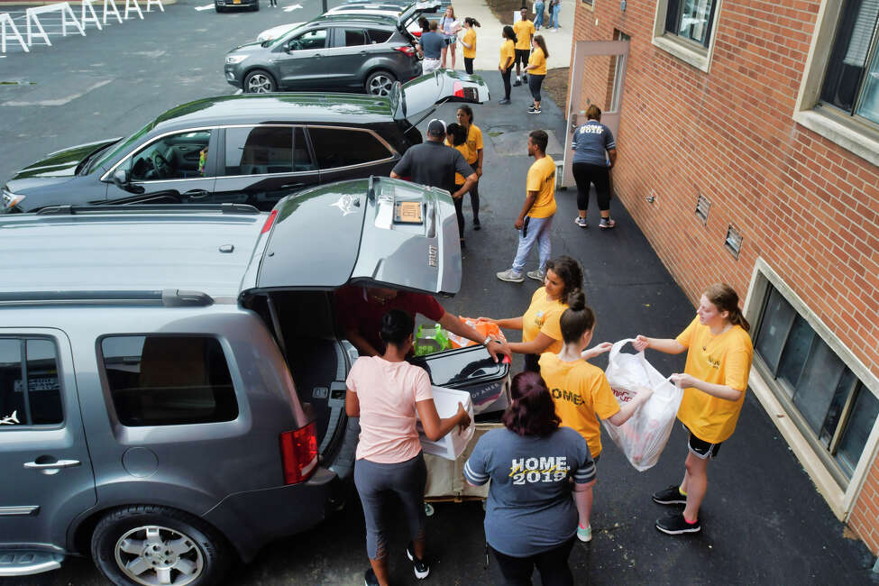 Upper class students help to unload the vehicles during move-in day for new students at The College of Saint Rose on Wednesday, Aug. 21, 2019, in Albany, N.Y. (Paul Buckowski/Times Union)