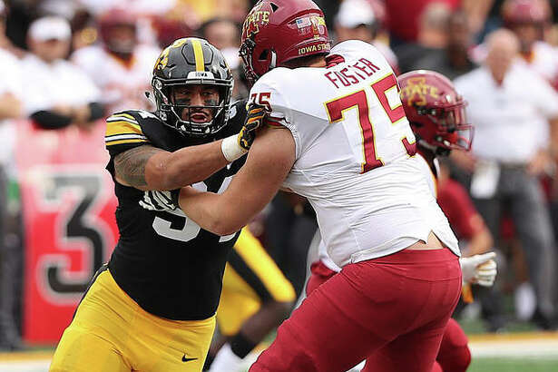 AJ Epenesa in action against Iowa State last year.