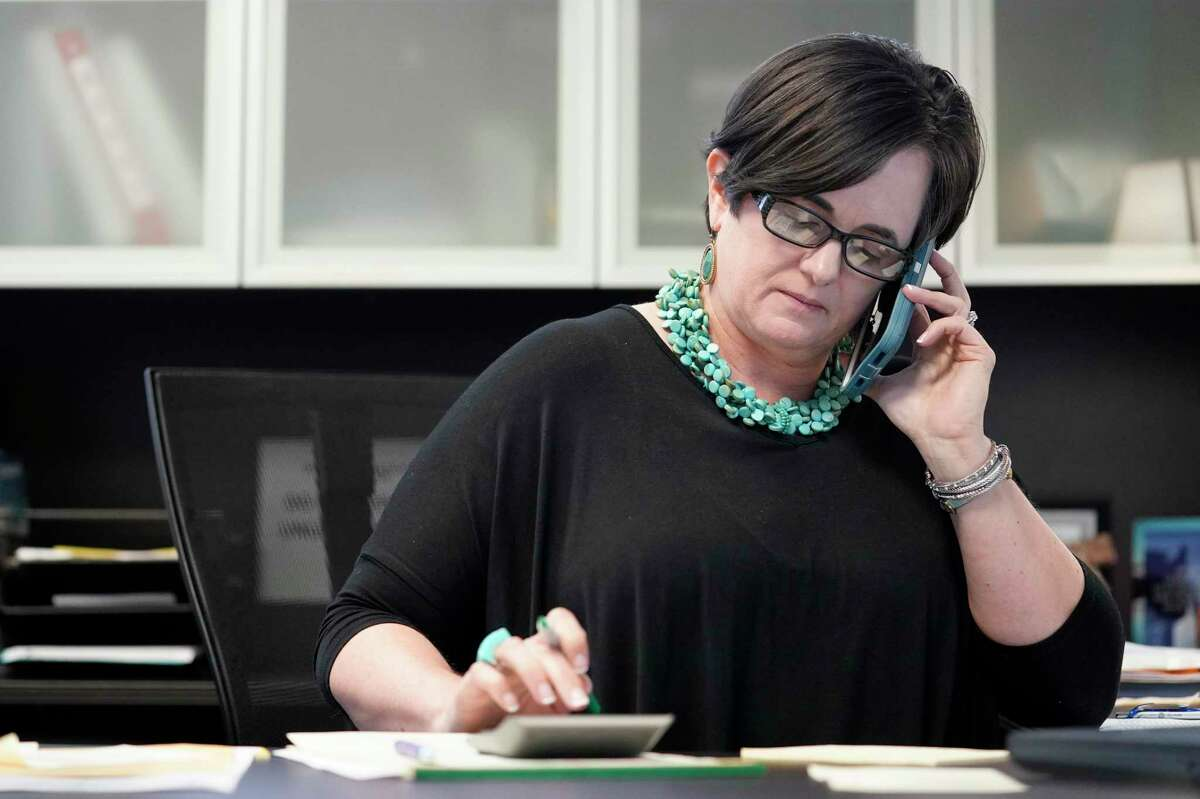 Jennifer Hughes Hernandez, a loan officer, works in her office at Legacy Mutual Mortgage, 2500 Citywest Blvd.,in Houston.