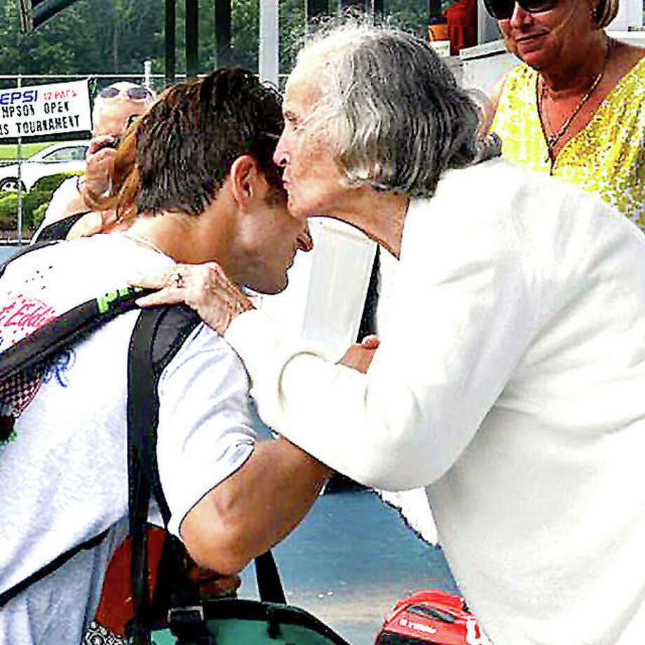 The late Andy Simpson plants a kiss on a Bud Simpson Open tennis tourney winner in 2014. Simpson, the widow of Bud Simpson, was an avid tennis fan. The annual Andy Simpson Doubles Tournament, held by the Alton High girls tennis team, is set for Saturday at the LCCC and Alton High Schoolcourts. Photo: Margie Barnes | Telegraph File